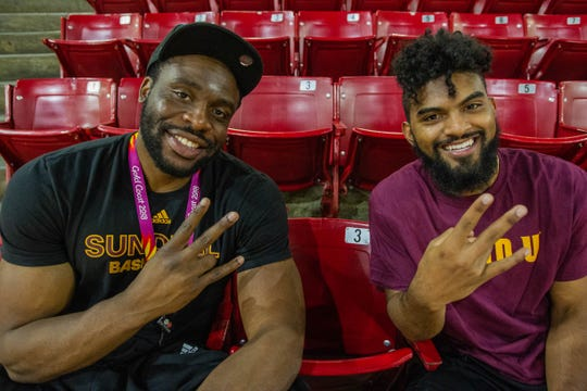 Former Sun Devil and Pac-12 Player of the Year Ike Diogu, left, and ASU Basketball guard Remy Martin pose for a photo in the Wells Fargo Arena on June 25, 2019.