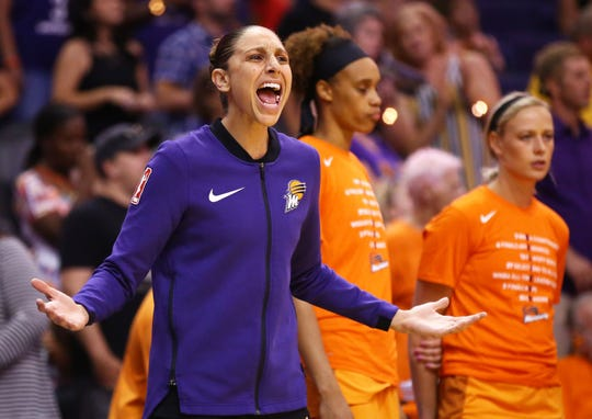 Mercury guard Diana Taurasi yells at the officials while sitting against the Fever on Friday.