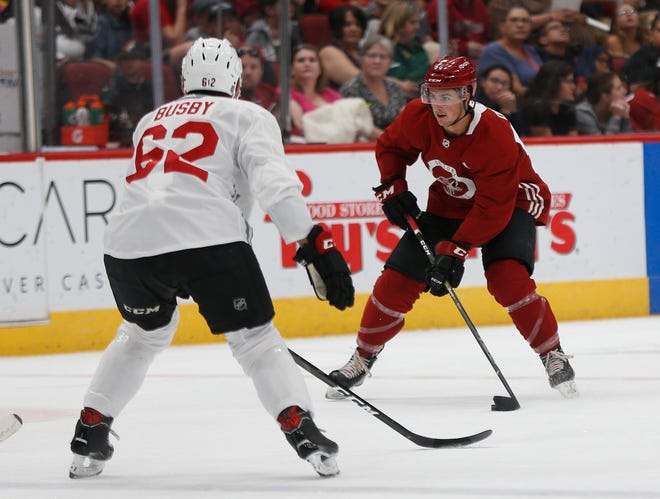 Coyotes' Cam Dineen (54) skates down the ice against Dennis Busby (62) during a scrimmage at Gila River Arena in Glendale, Ariz. on June 28, 2019.