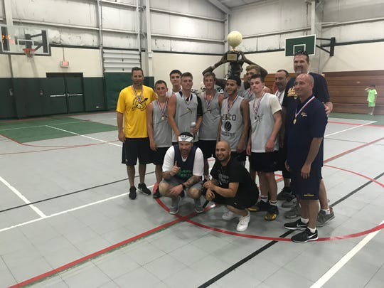 The Elco boys basketball team celebrates its Sweep The Streets high school title with, front row, event organizers Robert Cleapor and George Rodriguez