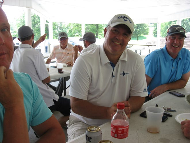 Jim Gardner, center, relaxes after his opening-round 63.