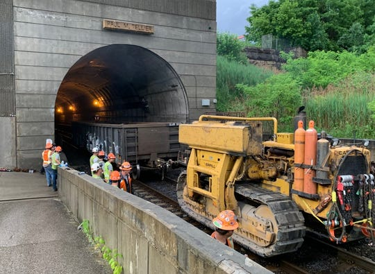 After CN Rail cars were removed from the 10th Street tunnel, pumping out the leaked sulfuric acid was expected to start Saturday.
