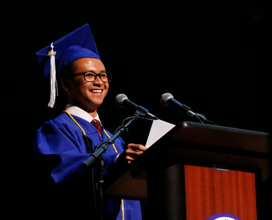 Valedictorian Minh Chau speaks at the Poughkeepsie High School graduation at the Majed J. Nesheiwat Convention Center on June 28, 2019.