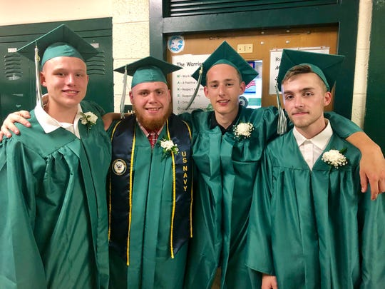 Webutuck grads and friends TroiHunter Cookingham, Brandon Cappella, Matt Intrieri and Jesse Jaynes pose before Friday's commencement ceremony.