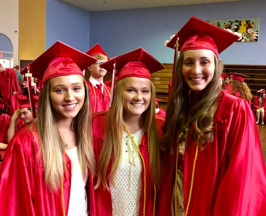 Former Red Hook High School girls lacrosse teammates Bailey Jordan, Ally McCrudden and Erin Hare pose together at Saturday's graduation.