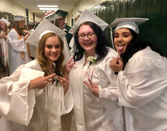Webutuck graduates Mikayla Cochrane, Jazzmin Thorn and Nicola DePino have fun before Friday's commencement ceremony.