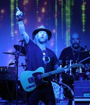 Devon Allman performing with the Allman Betts Band  on Parcel 5 during CGI Rochester International Jazz Festival.