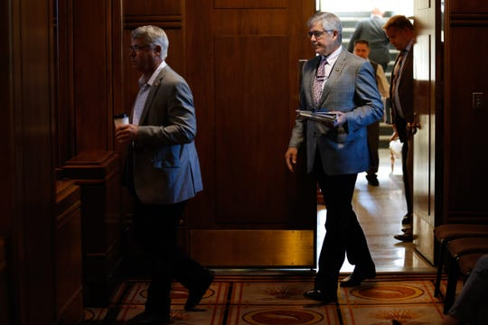 Sen. Chuck Thomsen, R-Hood River, (left) and Sen. Cliff Bentz, R-Ontario, return to the Oregon Senate floor for the first time since June 19 at the Oregon State Capitol in Salem, Oregon, on Saturday, June 29, 2019.