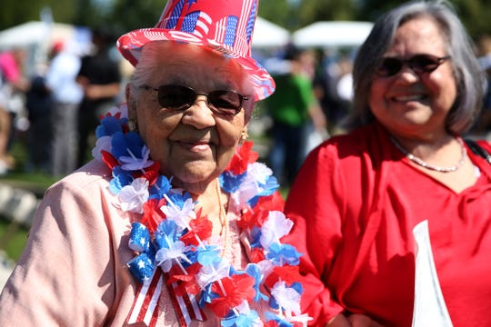 Amelia Miranda de Govea, 94, wears all kinds of American accessories after receiving her certificate of citizenship during the first naturalization ceremony held at the World Beat Festival at Riverfront Park in Salem on June 29, 2019. Hundreds attended the ceremony where 59 people from 26 countries were sworn in as U.S. citizens.