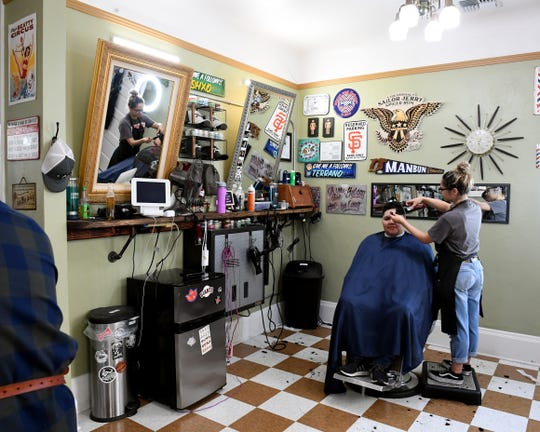 A client gets their hair cut at Furey's Old Town Barber. June 22, 2019.