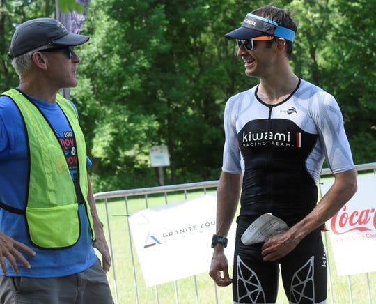 Men's Olympic division champion Joshua Mork (right) talks with course director Larry Stracke on Saturday, June 29, 2019 at the Graniteman Clearwater Triathlon.