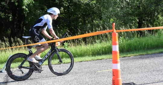 Joshua Mork of Lino Lakes begins the cycling portion of the Graniteman Clearwater Triathlon on Saturday, June 29, 2019 at Warner Lake County Park.