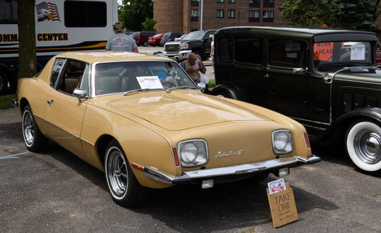 Doug Rask's 1975 Studebaker Avanti II sits with other classic cars at a Pantowners Car Show, Saturday, June 29, 2019 at the East Side Block Party on East Germain St. Rask has owned the Avanti for about 20 years.