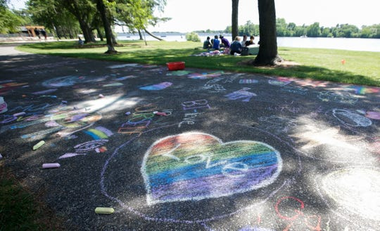 Pride-themed street art is displayed on the sidewalk during the inaugural Stevens Point Pride Day on Saturday, June 29, 2019, at Pioneer Park in Stevens Point, Wis. Tork Mason/USA TODAY NETWORK-Wisconsin