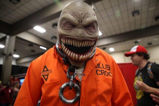 Scott Dierksheide shows off his detailed Killer Croc costume at Infinity Con Saturday, June 29, 2019.