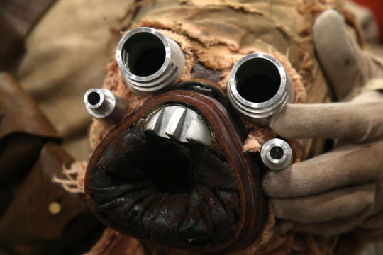 Dallas Fillmon shows off all of the details and work he put into creating his Tusken Raider costume for Infinity Con at the Tucker Civic Center Saturday, June 29, 2019.