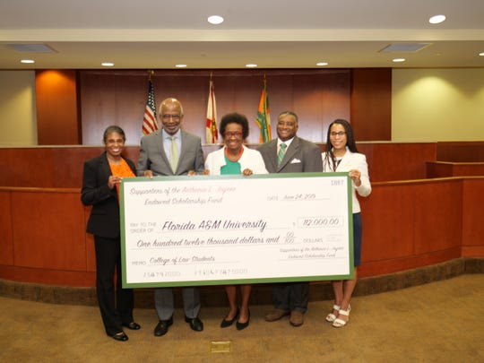 FAMU President Larry Robinson announces endowed scholarship in honor of former Florida Senate Minority Leader Athenia L. Joyner (center) on June 24, 2019 in Orlando.