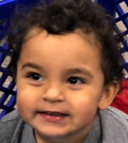 Matias Carrillo, 2, is 3 feet tall, weighs 50 pounds, and has black hair and brown eyes. He was wearing a gray onesie.