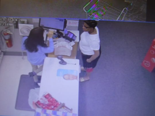 Police say this woman, in her 30s to 40s, was part of a scam at a Walgreens store on the West Side.