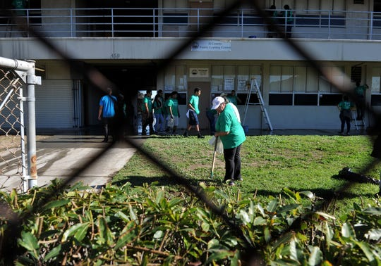Volunteers in 2015 are seen in this file photo cleaning up Campus Park at a community event. Oxnard is getting ready to submit a grant to develop the site of the old Oxnard High School.
