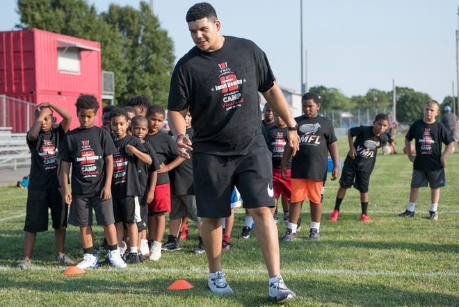 Jamil Demby, a Vineland High School graduate and current Los Angeles Rams offensive lineman, leads a drill as he holds a free youth football camp in 2019. He returns to host another football camp on Saturday.