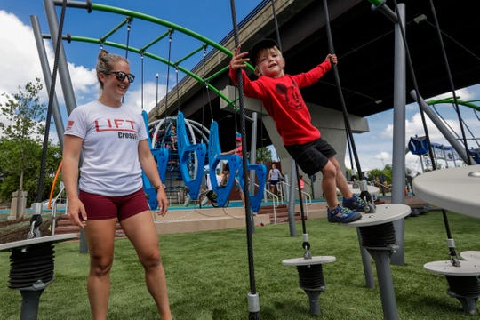 Leah Alters watches her 3-year-old son Owen climbs on an obstacle Friday, June 28, 2019, at the Riverlife Park in Wausau, Wis. T'xer Zhon Kha/USA TODAY NETWORK-Wisconsin