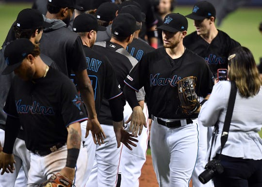 Jun 28, 2019; Miami, FL, USA; Miami Marlins players celebrate their win over the Philadelphia Phillies at Marlins Park. Mandatory Credit: Steve Mitchell-USA TODAY Sports