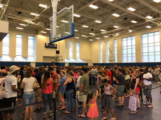 Hundreds of people wait in line to enter the Mega Adoption event. The line crisscrossed through the University of Delaware practice gyms at the Bob Carpenter Center and the arena's lobby.