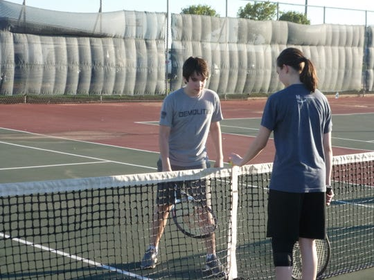 Alex Nash and Alyssa Nash play a game of roll ball earlier this month at the Neighborhood Tennis Program.