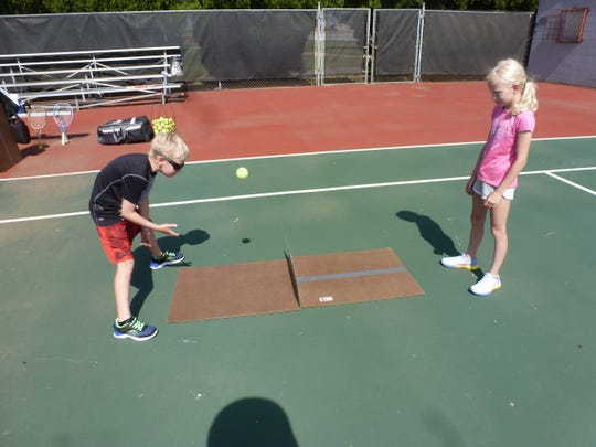 Ben Miller and Bekah Miller play a game without rackets at McNiel at the Neighborhood Tennis Program.