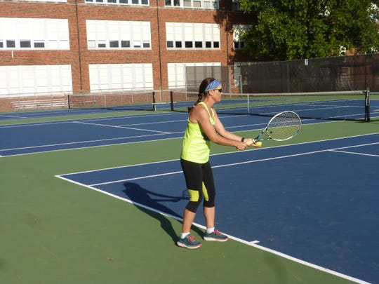 Teresa Rose prepares to serve during a session at the Neighborhood Tennis Program.