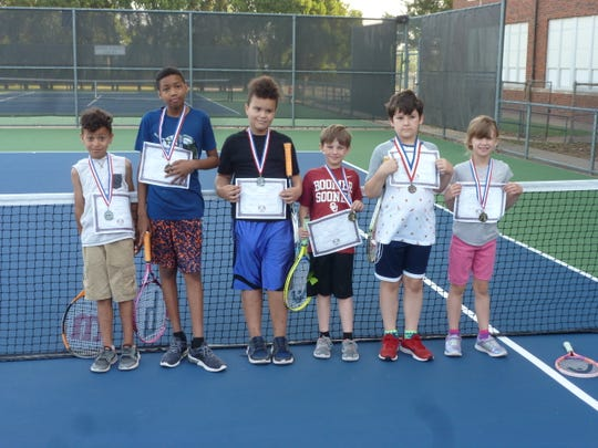 Braxton Sims (from left to right) Jamariyon Henry, Treyden Sims, Kaden Koetter, Kael Duncan and Camryn Duncan show off their certificates from the Neighborhood Tennis Program.