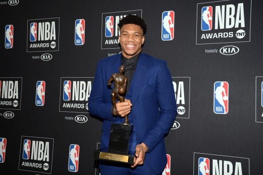 Giannis Antetokounmpo poses with the NBA MVP award.