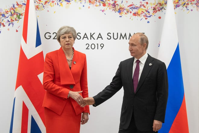 Britain's Prime Minister, Theresa May, meets Russia's President, Vladimir Putin, during a bilateral meeting on the first day of the G20 summit on June 28, 2019, in Osaka, Japan.
