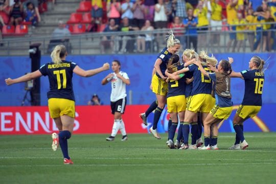 Swedish players celebrate after beating Germany 2-1 to reach the Women's World Cup semifinals.