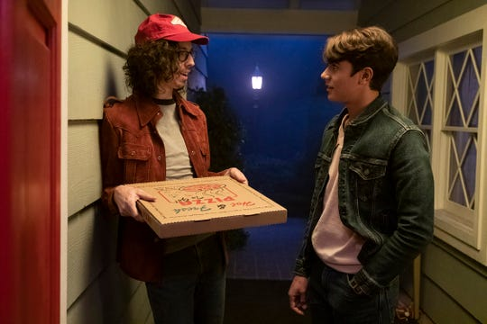 "Bill Kottkamp as Pizza Guy and Michael Cimino as Bob Palmeri in ""Annabelle Comes Home."""