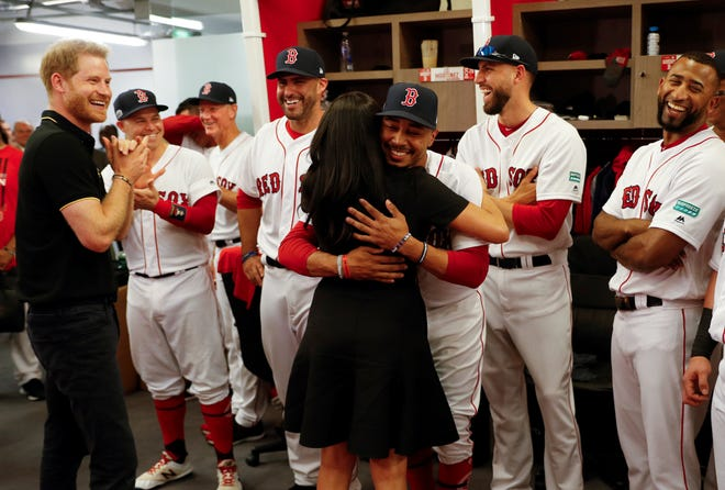 Meghan Markle hugs Red Sox outfielder Mookie Betts on Saturday.