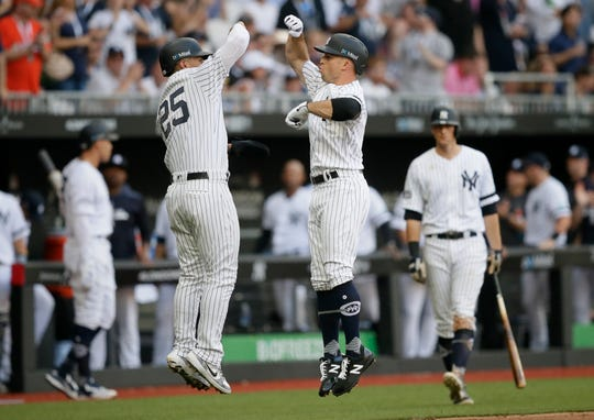 Brett Gardner, right, celebrates with teammate Gleyber Torres after a home run.