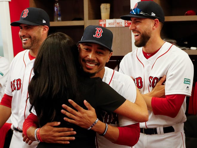 Meghan hugs Red Sox outfielder Mookie Betts.