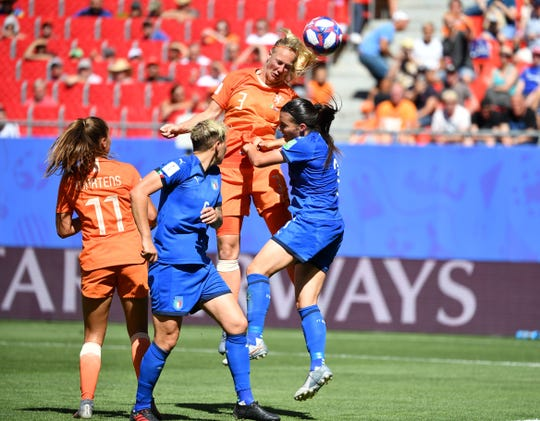 The Netherlands' Stefanie van der Gragt (3) heads the ball in for a goal against Italy.
