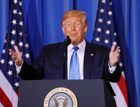 President Donald Trump is pictured speaking during a news conference at a hotel in Osaka, Japan.
