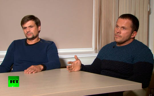 In this video grab provided by the RT channel , Ruslan Boshirov, left, and Alexander Petrov attend their first public appearance in an interview with the Kremlin-funded RT channel in Moscow on Sept. 13, 2018.