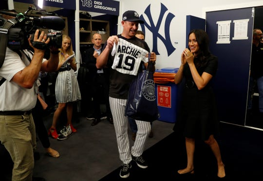Yankees manager Aaron Boone gives Meghan a baby gift.