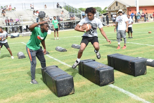 Young campers participate during drills at Demar Dotson's 2019 Youth Football camp at Frank O. Hunter Park Saturday, June 29, 2019. This is the fifth year Dotson has held the free camp for area youth which he wants to inspire and teach them proper skills and techniques.