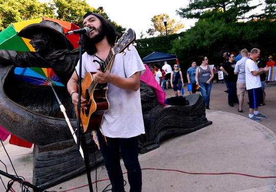 Jonathan Hester performs an acoustic set during Saturday's Pride in the Park gathering at Everman Park.