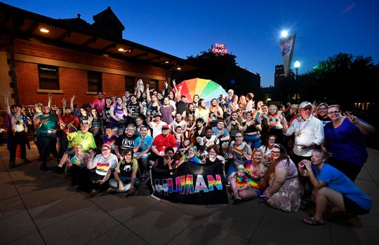 Near the end of the evening Saturday, attendees of Pride in the Park gather for a group photo in Everman Park. Organizers called the evening a celebration of the Abilene area LGTBQ community