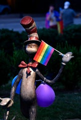 The Cat in the Hat statue in Everman Park holds a Pride flag during Saturday's Pride in the Park gathering. The crowd numbered about 200, with some driving and others leaving through the course of the evening. Organizers called it a celebration of the Abilene area LGTBQ community.