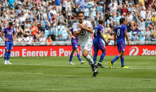 June 29, 2019: Minnesota United midfielder Hassani Dotson (31) celebrates after scoring a goal against FC Cincinnati during the first half at Allianz Field in Saint Paul, Minnesota.