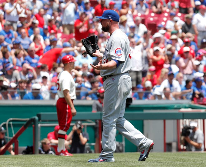 Jun 30, 2019; Cincinnati, OH, USA; Chicago Cubs starting pitcher Jon Lester (34) reacts after giving up a three-run home run to Cincinnati Reds third baseman Eugenio Suarez (not pictured) during the first inning at Great American Ball Park. Mandatory Credit: David Kohl-USA TODAY Sports