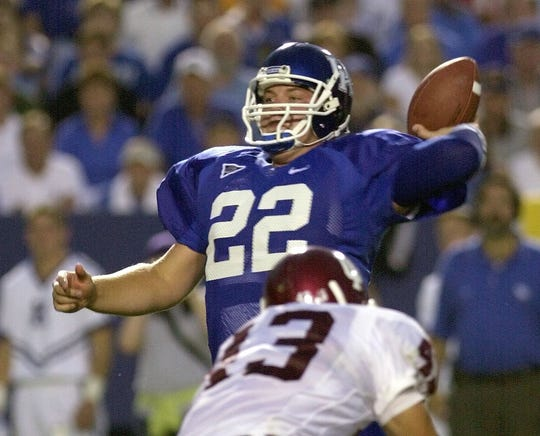Sept. 14, 2002: Kentucky quarterback Jared Lorenzen tosses a touchdown pass to receiver Aaron Boone over Indiana linebacker Kyle Killion during the first half in Lexington, Ky.